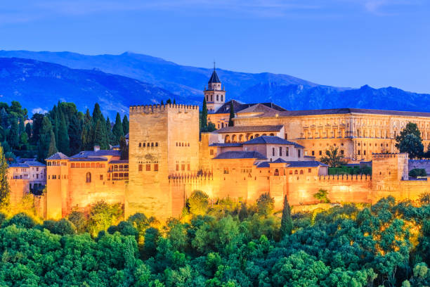Alhambra of Granada, Spain. Alhambra of Granada, Spain. Alhambra fortress at twilight. palace of charles v stock pictures, royalty-free photos & images
