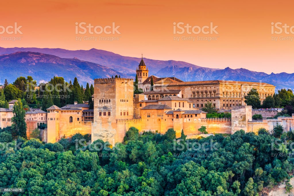 Alhambra of Granada, Spain. Alhambra of Granada, Spain. Alhambra fortress at sunset. Ancient Stock Photo