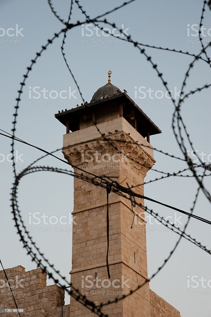 Al-Ibrahimi Mosque Minaret and Barbed Wire royalty-free stock photo