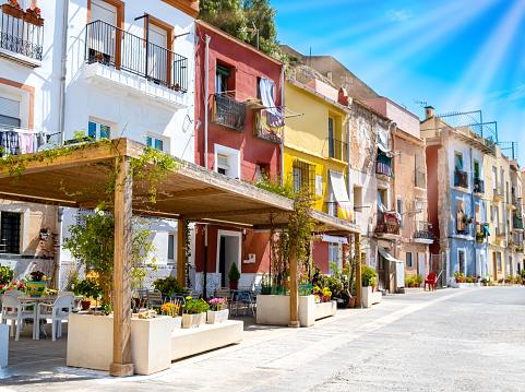Alicante old town with colorful houses in ancient neighborhood El Barrio or Casco Antiguo Santa Cruz, Costa Blanca region on Mediterranean sea coast, Spain