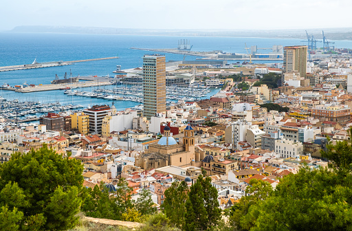 Alicante old town with narrow streets, ancient houses, port with yachts and Cathedral. Historic neighborhood Casco Antiguo Santa Cruz. Costa Blanca region in Spain.