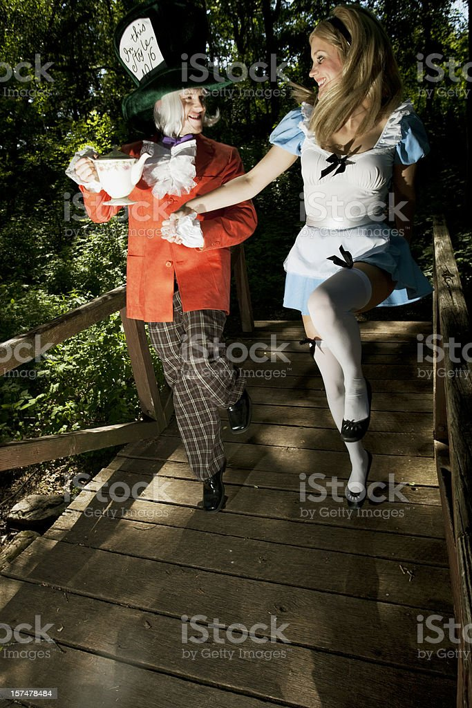 Alice meets the Mad Hatter royalty-free stock photo