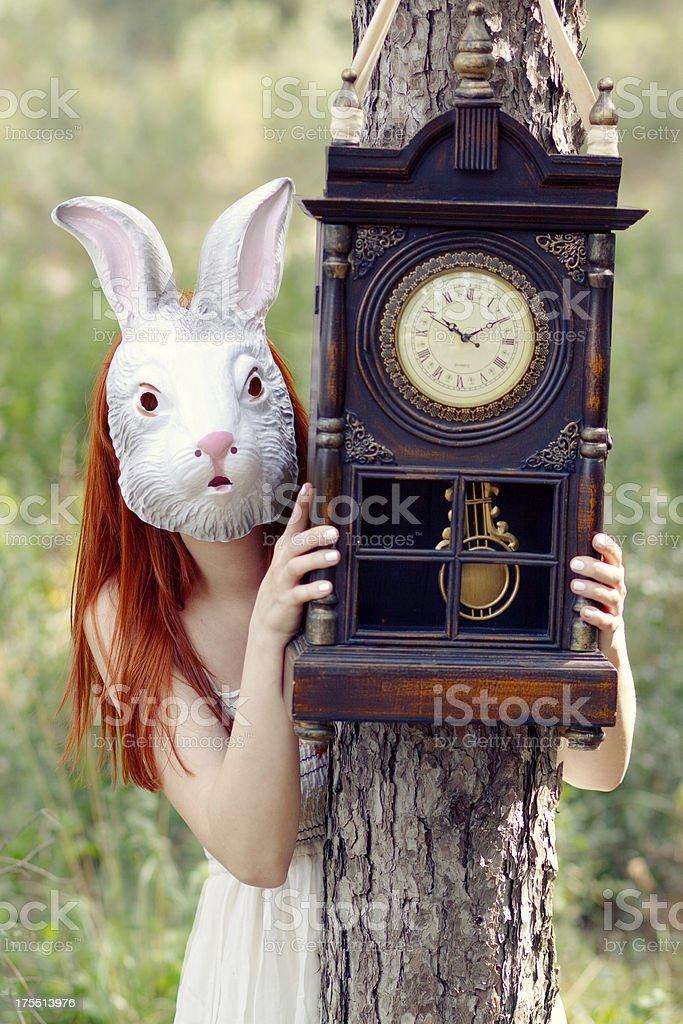Alice with Clock stock photo