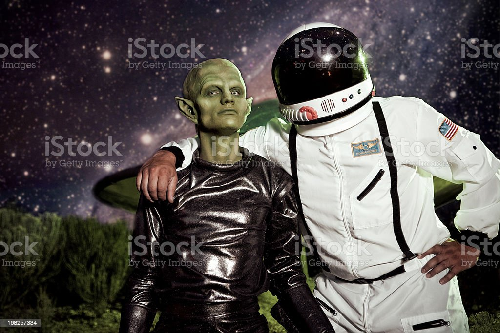 Alien and Astronaut UFO Spaceship Landing royalty-free stock photo