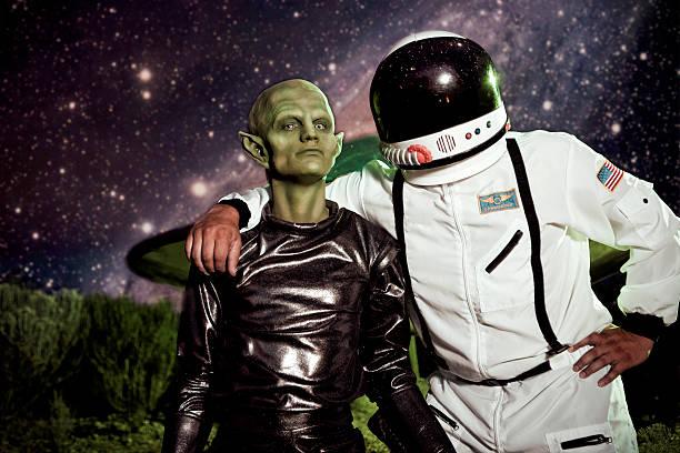 Alien and Astronaut UFO Spaceship Landing stock photo