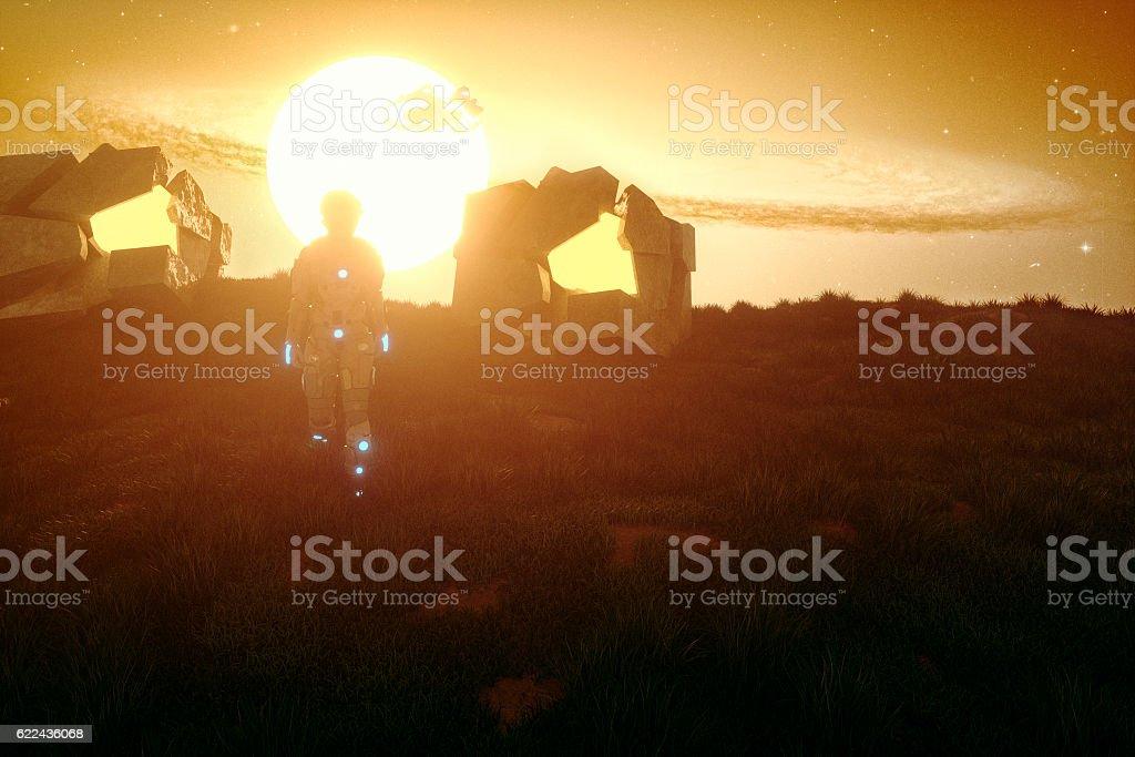 Alien cyborg landing on a green planet stock photo