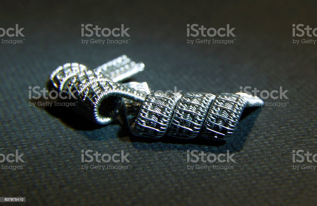 Alien framed staggered fused clapton coil for vaping rebuildable atomizer stock photo