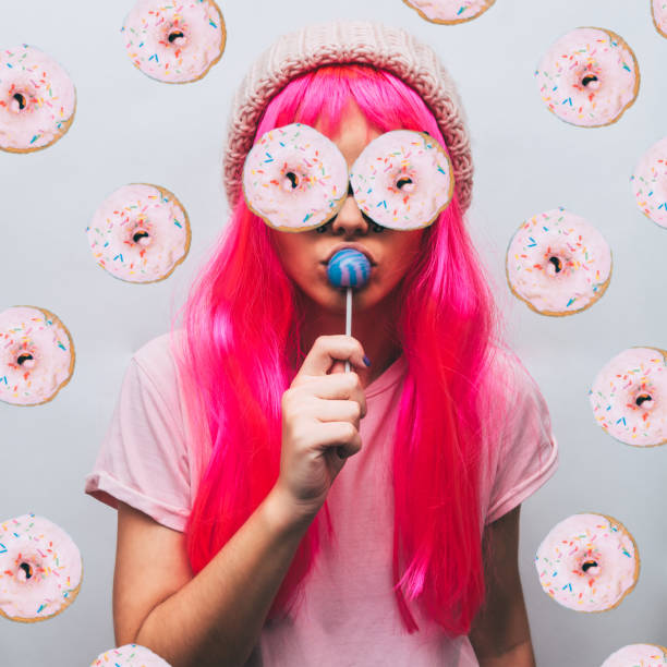 alien girl with donuts stock photo