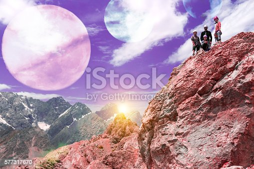 istock Alien Planet Mountain Landscape and Climbers on Top 577317670