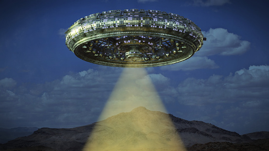 Ufo Alien Spaceship With Light Beam Hovering In The Night