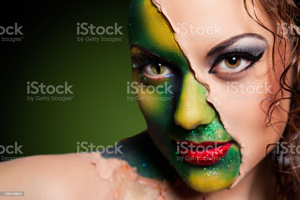 Alien woman covered in human skin royalty-free stock photo