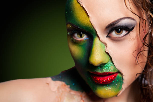 Alien woman covered in human skin stock photo