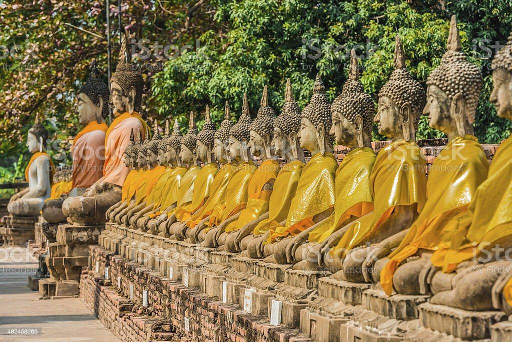 aligned buddha statues Wat Yai Chaimongkol Ayutthaya bangkok thailand stock photo