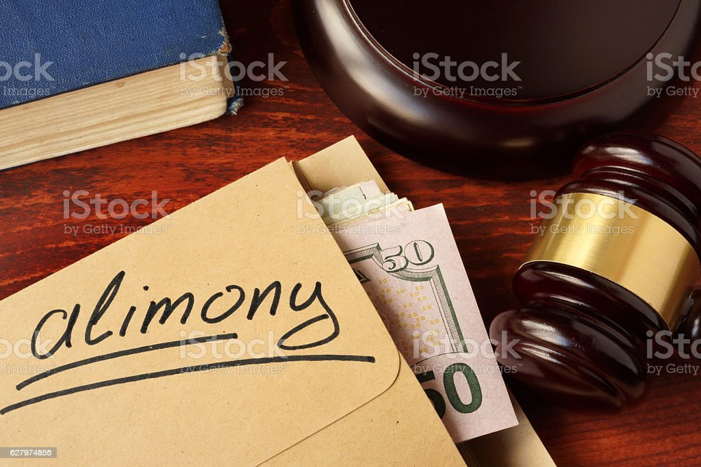 Alimony concept. An envelope with cash on a table. stock photo