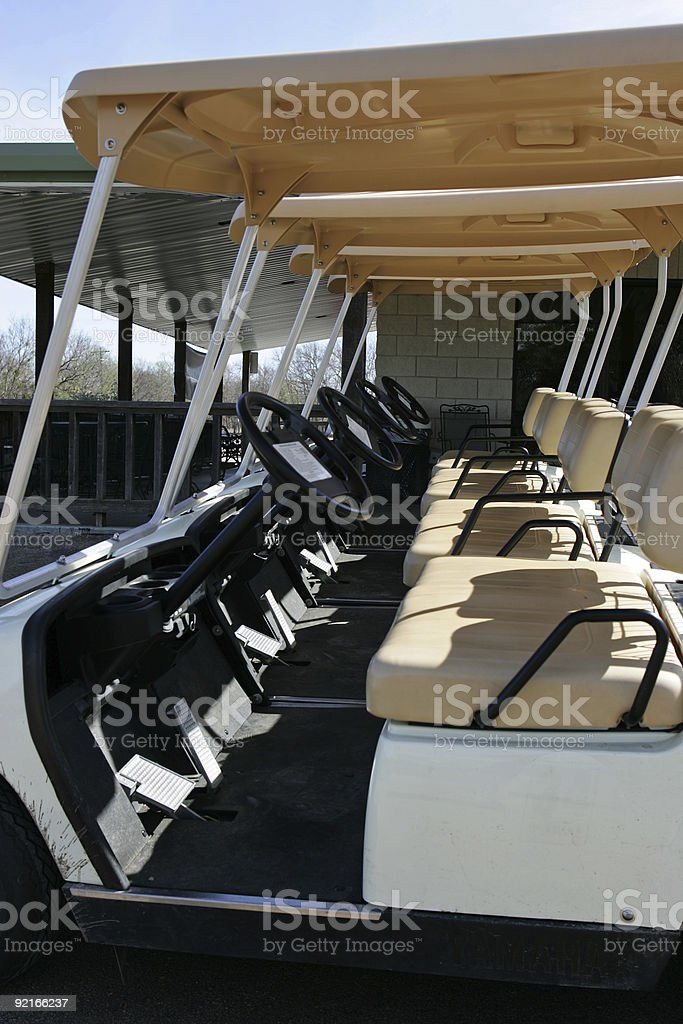 Aline of golf carts royalty-free stock photo