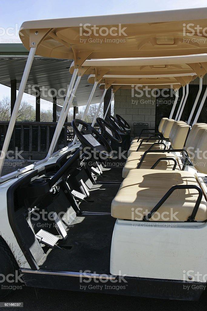 Aline of golf carts stock photo
