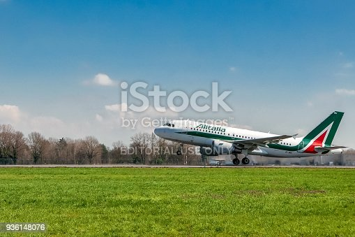 istock Alitalia airplane landing on runway 936148076