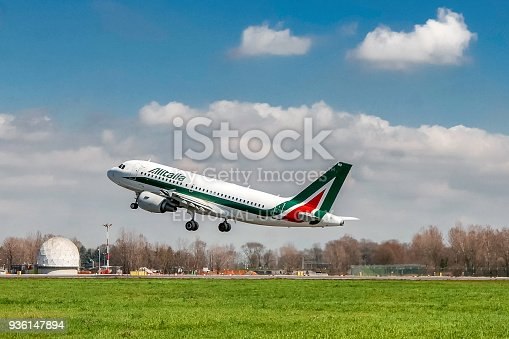 istock Alitalia airplane taking off on runway 936147894