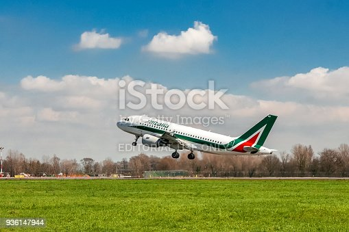 istock Alitalia airplane taking off on runway 936147944