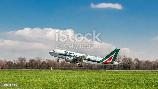 istock Alitalia airplane taking off on runway 936147980