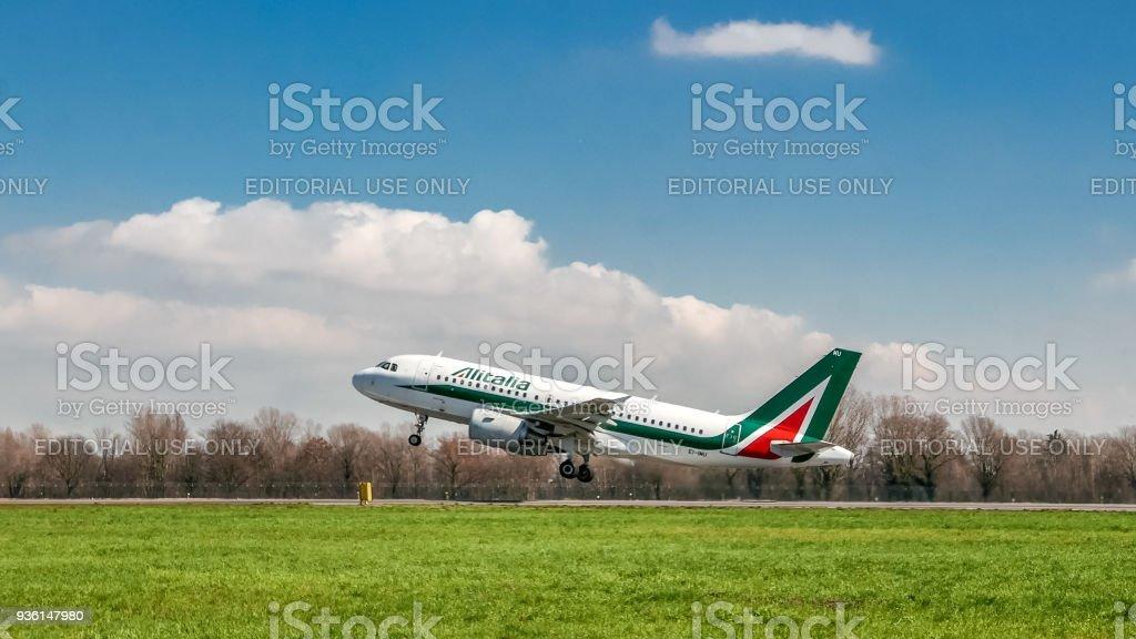 Alitalia airplane taking off on runway - foto stock