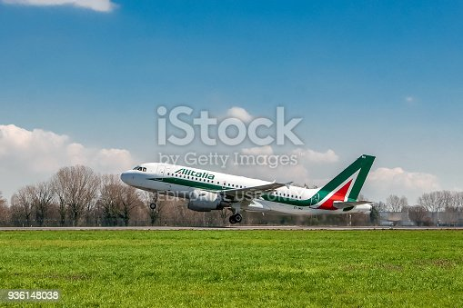 istock Alitalia airplane taking off on runway 936148038