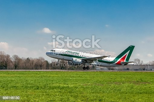 istock Alitalia airplane taking off on runway 936148130