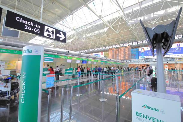 Alitalia check in counter Leonardo da Vinci Fiumicino airport Rome Italy stock photo