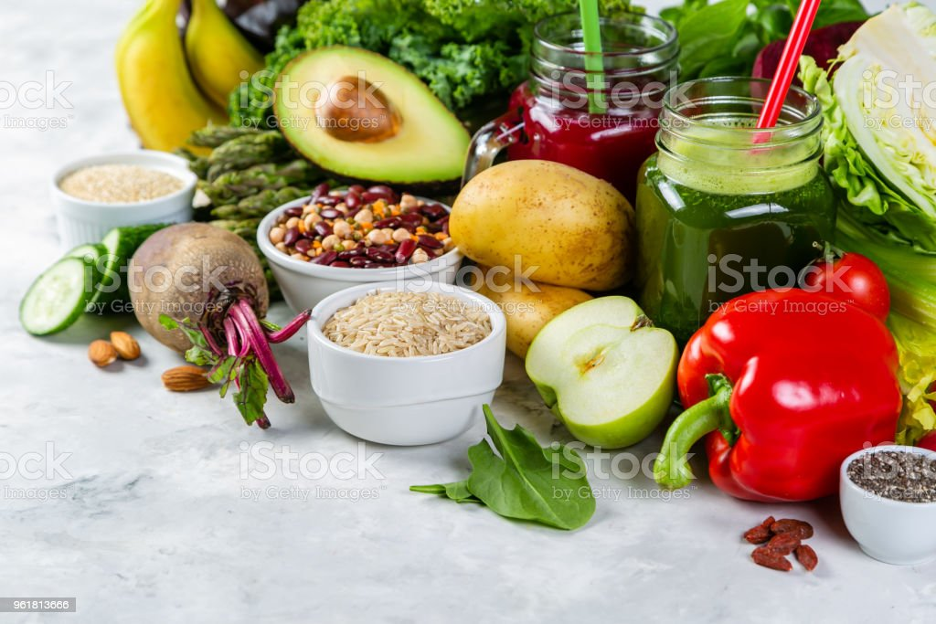 Alkaline diet concept - fresh foods on rustic background stock photo