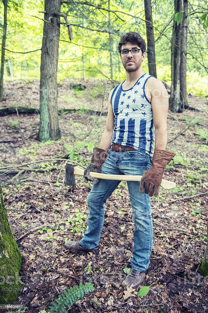 All American Man Chopping Down Trees royalty-free stock photo
