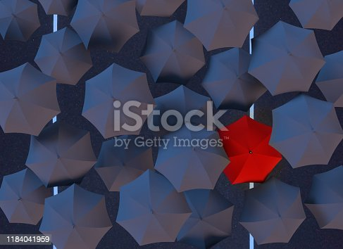 All black umbrellas but one red one