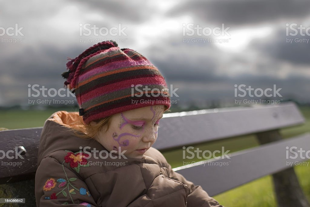 """All dressed up and no place to go """"Sad 5 year old girl wearing makeup, sitting sad and alone on a bench."""" Abandoned Stock Photo"""