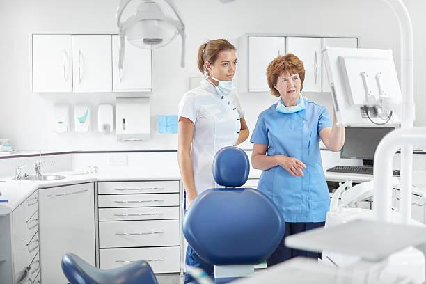 all female dental team - two dentists talking bildbanksfoton och bilder