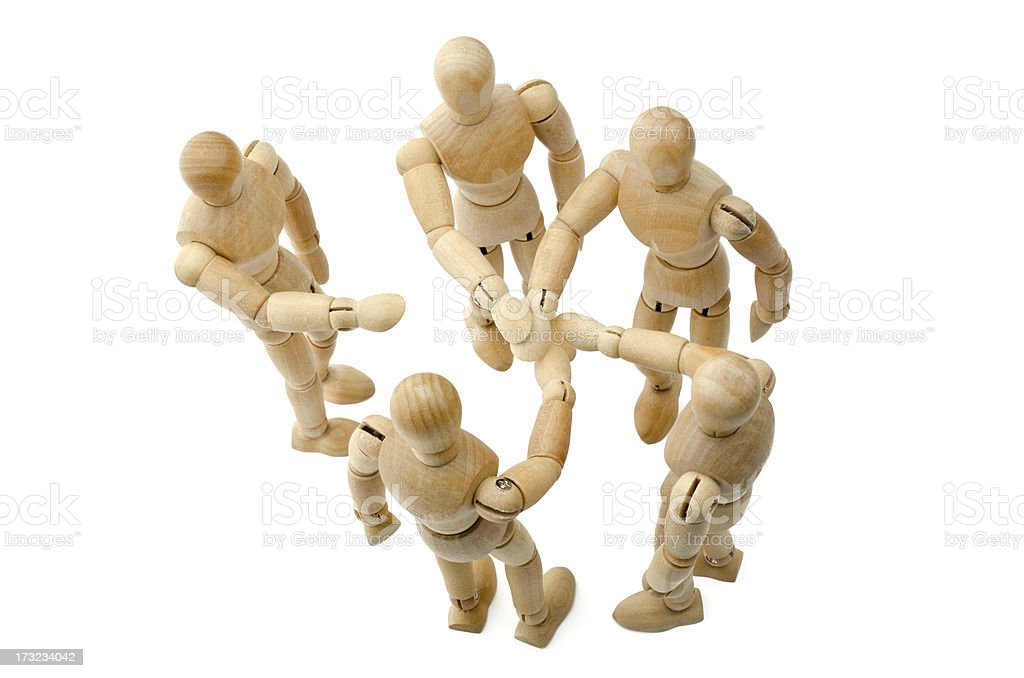 all for one - Wooden mannequin putting hands together royalty-free stock photo