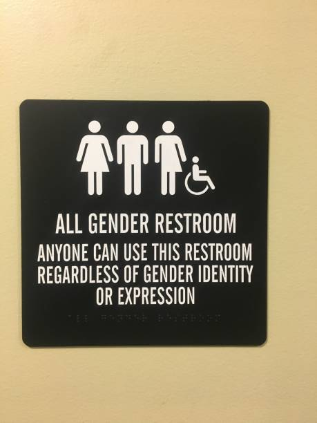 All gender restroom An office building on the United States offers a distinct restroom allowing all genders and identities to use transgender stock pictures, royalty-free photos & images