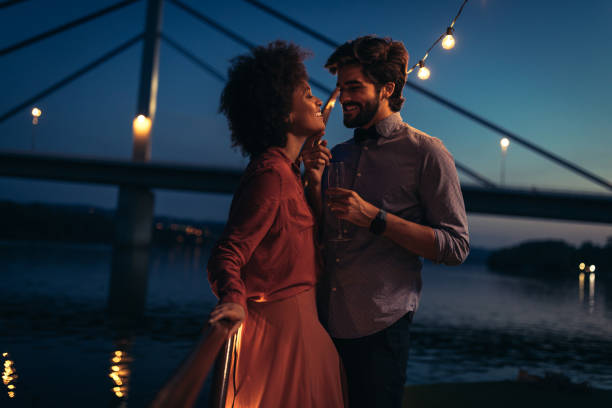 All I need is you Shot of young affectionate couple on a boat cruise date night romance stock pictures, royalty-free photos & images