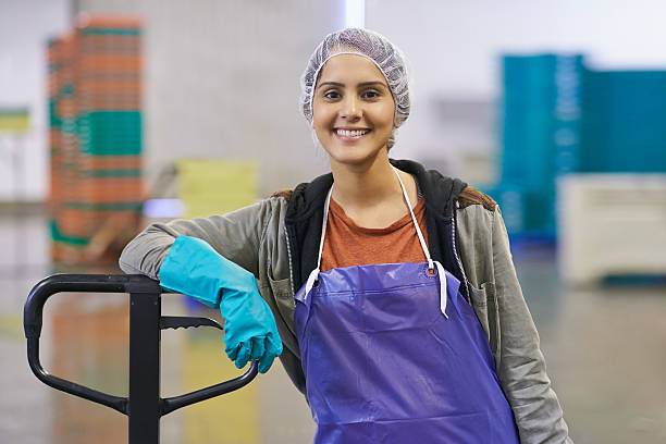 All in a day's work Shot of a woman working in a food processing planthttp://195.154.178.81/DATA/i_collage/pu/shoots/805486.jpg food warehouse stock pictures, royalty-free photos & images