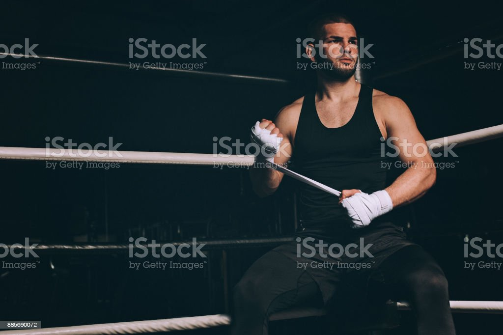 MMA fighter preparing bandages for training