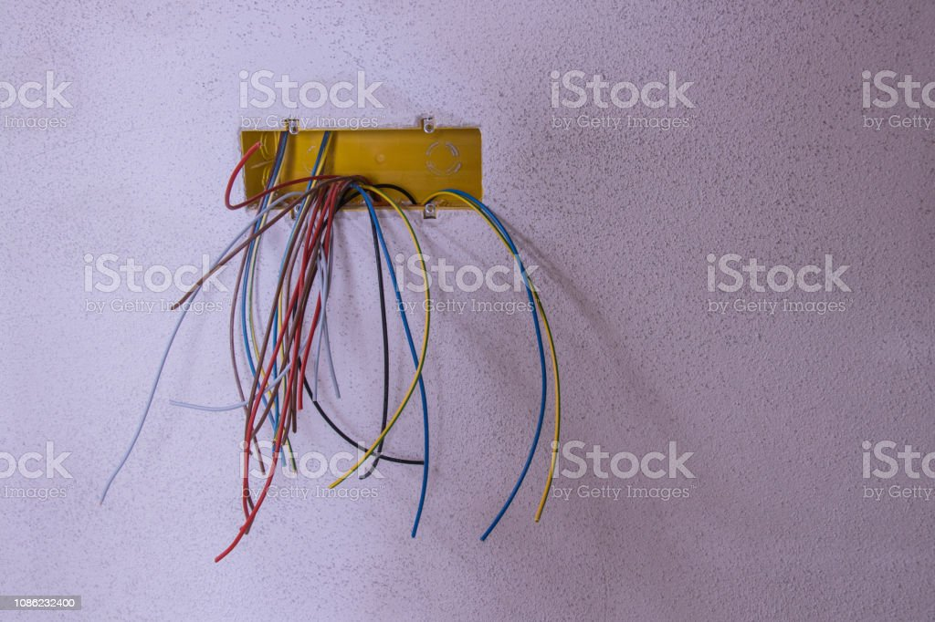 all kinds of colorful cables on the wall stock photo