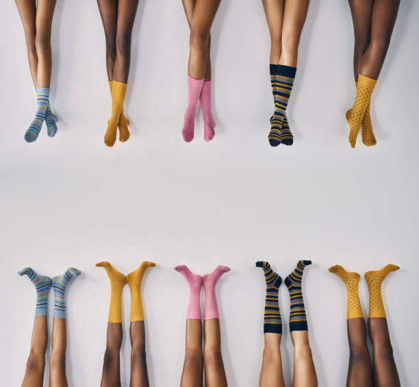 All kinds of socks to suit all kinds of feet Cropped studio shot of a group of women's legs in a row wearing socks sock stock pictures, royalty-free photos & images