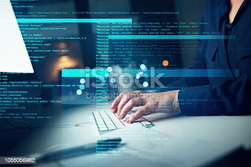 Closeup shot of an unrecognizable programmer working on a computer code at night