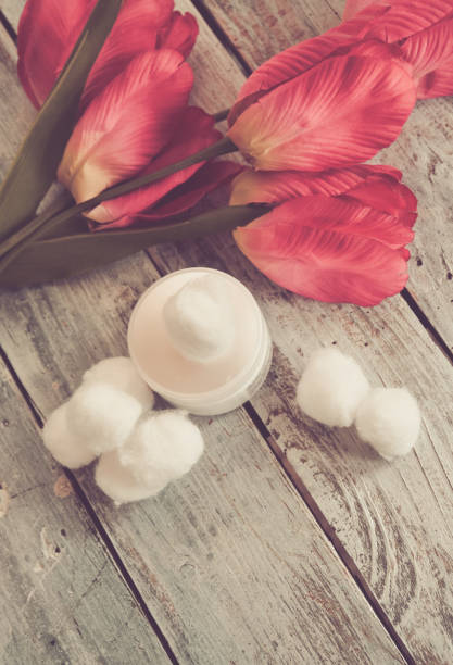 All natural Cotton Balls, Tulips and Copy Space stock photo