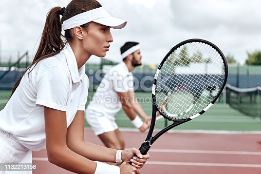 istock All or nothing. Beautiful woman and handsome man are competely focused on the game 1132213156