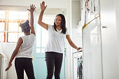Shot of a mother and daughter high-fiving after finishing their chores