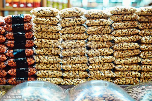 Shot of packets full of nuts stacked on top of each other ready to be sold at a market during the day