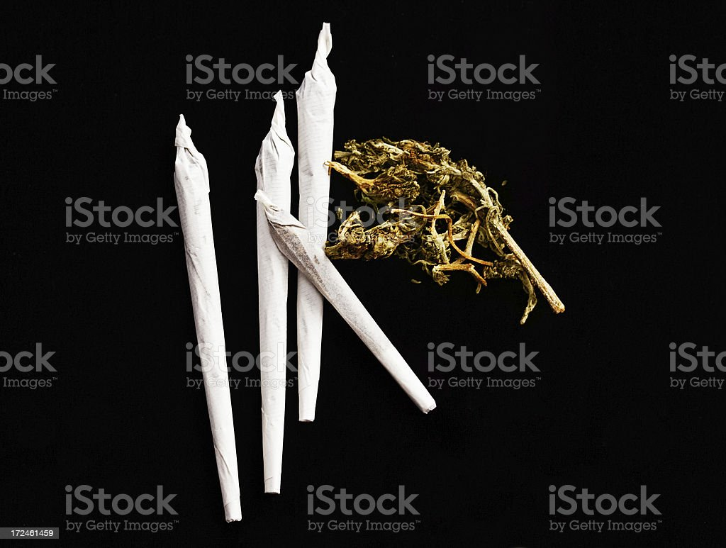 All ready to get very high: four hand-rolled marijuana joints stock photo