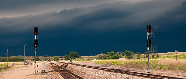all red stop lights for coal transport in a storm - railway signal stock photos and pictures