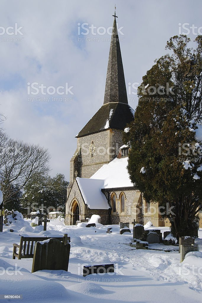 All Saints Church in snow at Banstead,Surrey, England royalty-free stock photo