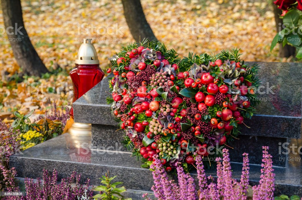 all saints day in the autumn cemetery stock photo