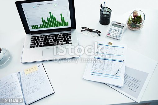 High angle shot of a desk with various items on it in a financial company